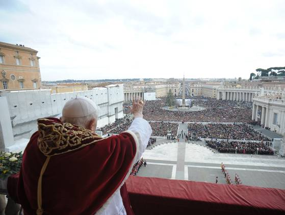 "Pope Benedict XVI delivering the Vatican's traditional Christmas Day ""Urbi et Orbi""(to the City and to the World) Message from the central balcony of Saint Peter's Basilica on Tuesday, December 25, 2012."