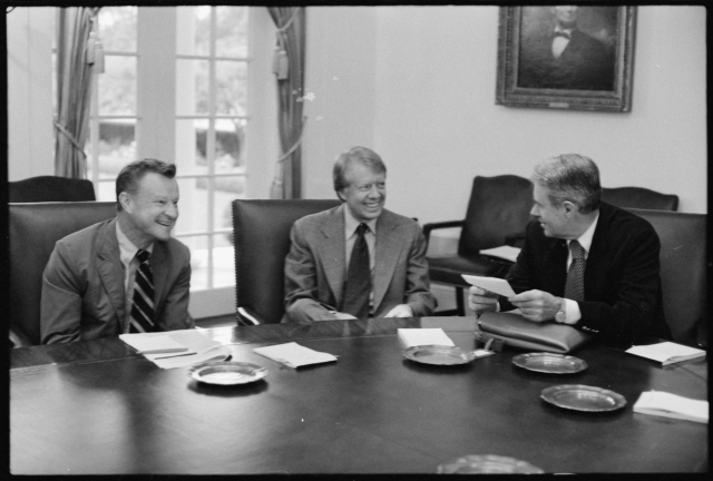 In this photo image from 1977, National Security Adviser Zbigniew Brzezinski is seen with US President Jimmy Carter and US Secretary of State Cyrus Vance. President Carter had reversed the policy of Dr. Henry Kissinger and had issued US visa to His Holiness the 14th Dalai Lama during 1979.