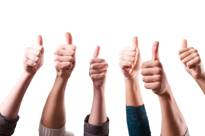 """WHOLE TEAM - WHOLE TRADITION - WHOLE CONCEPTION: WHEN A GROUP OF PEOPLE WORKING TOGETHER AS A """"TEAM"""" JOIN IN AN ACT OF COLLECTIVE APPRECIATION SUCH AS GIVING THE """"THUMBS UP"""" SIGN TO SAY THAT THEY ARE PLEASED PROVIDES REINFORCEMENT TO THE EXPERIENCE OF HAPPINESS AND THE FEELINGS OF JOB SATISFACTION AT WORKPLACE."""