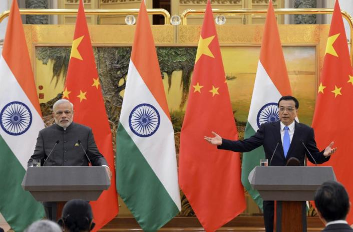 Indian Prime Minister Narendra Modi, left, and Chinese Premier Li Keqiang hold a press conference at the Great Hall of the People in Beijing, China Friday, May 15, 2015. (Kenzaburo Fukuhara/Pool Photo via AP)