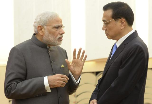 Indian Prime Minister Narendra Modi, left, talks with Chinese Premier Li Keqiang after a press conference at the Great Hall of the People in Beijing Friday, May 15, 2015. (Kenzaburo Fukuhara/Pool Photo via AP)