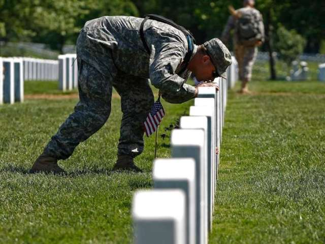 memorial day soldier kissing a grave