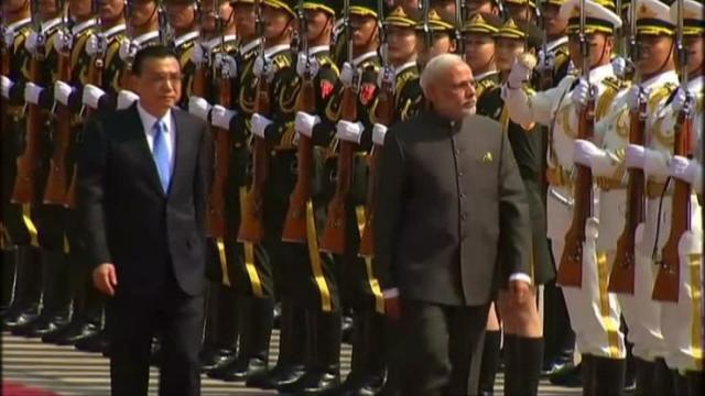 INDIAN PRIME MINISTER'S VISIT TO RED CHINA .
