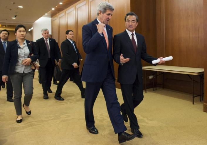 "Chinese Foreign Minister Wang Yi (R) and US Secretary of State John Kerry walk to a joint news conference following meetings at the Ministry of Foreign Affairs in Beijing May 16, 2015. The United States and China clashed over a territorial dispute in the South China Sea on Saturday, as China's foreign minister asserted its sovereignty to reclaim reefs saying its determination to protect its interests is ""as hard as a rock"".REUTERS/Saul Loeb/Pool"