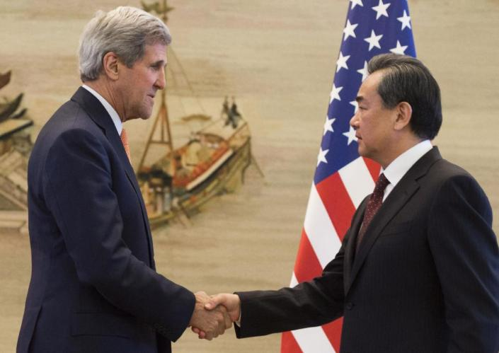 U.S. Secretary of State John Kerry, left, shakes hands with Chinese Foreign Minister Wang Yi after their press conference following their meetings at the Ministry of Foreign Affairs in Beijing Saturday, May 16, 2015. Kerry is in China to press Beijing to halt increasingly assertive actions it is taking in the South China Sea that have alarmed the United States and China's smaller neighbors. (Saul Loeb/Pool Photo via AP)