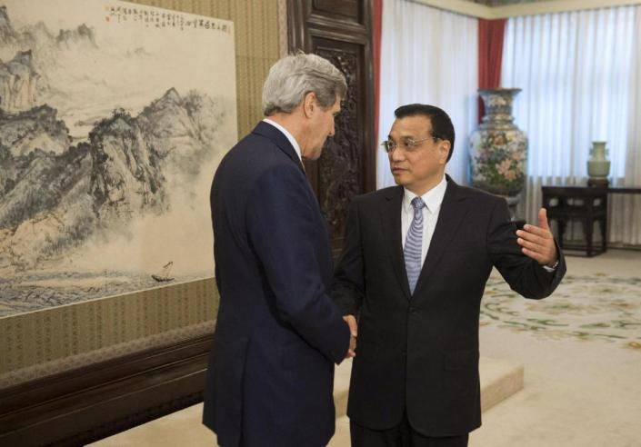 U.S. Secretary of State John Kerry, left, and Chinese Premier Li Keqiang talk during a meeting at Zhongnanhai Leadership Compound in Beijing Saturday, May 16, 2015. The United States and China held firm Saturday to deep disagreements over increasingly assertive Chinese activity in disputed areas of the South China Sea, as Beijing politely but pointedly rejected U.S. Secretary of State John Kerry's push for it to reduce tensions. (Saul Loeb/Pool Photo via AP)