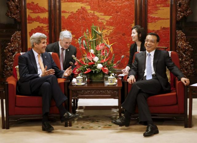 "U.S. Secretary of State John Kerry (L) speaks with Chinese Premier Li Keqiang at the Zhongnanhai Leadership Compound in Beijing, China, May 16, 2015. The United States and China clashed over a territorial dispute in the South China Sea on Saturday, as China's foreign minister asserted its sovereignty to reclaim reefs saying its determination to protect its interests is ""as hard as a rock"". REUTERS/Kim Kyung-Hoon"