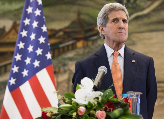 U.S. Secretary of State John Kerry attends a joint press conference with Chinese Foreign Minister Wang Yi following their meetings at the Ministry of Foreign Affairs in Beijing Saturday, May 16, 2015. Kerry is in China to press Beijing to halt increasingly assertive actions it is taking in the South China Sea that have alarmed the United States and China's smaller neighbors. (Saul Loeb/Pool Photo via AP)