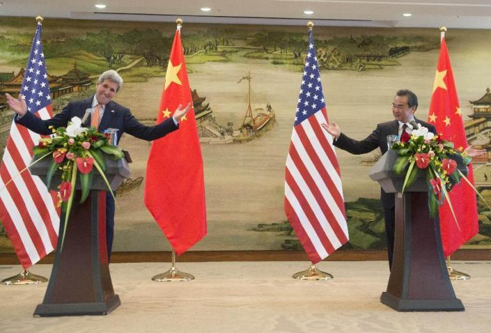 U.S. Secretary of State John Kerry, left, and Chinese Foreign Minister Wang Yi hold a joint press conference following their meetings at the Ministry of Foreign Affairs in Beijing Saturday, May 16, 2015. Kerry is in China to press Beijing to halt increasingly assertive actions it is taking in the South China Sea that have alarmed the United States and China's smaller neighbors. (Saul Loeb/Pool Photo via AP)