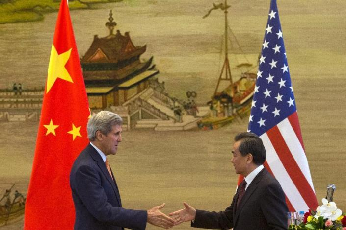U.S. Secretary of State John Kerry, left, and Chinese Foreign Minister Wang Yi shake hands after a press conference following meetings at the Ministry of Foreign Affairs in Beijing Saturday, May 16, 2015. U.S. Secretary of State John Kerry is urging China to halt increasingly assertive actions it is taking in the South China Sea. (AP Photo/Ng Han Guan, Pool)