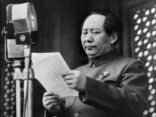 Mao Zedong proclaims the founding of the People's Republic of China in Beijing on Oct. 1, 1949. HE  WAS  ENRAGED  BY  MOSCOW'S  DECISION  TO  SUSPEND ASSISTANCE  TO  RED  CHINA'S  NUCLEAR  PROGRAM  ON  JUNE 20, 1959. FROM  THAT  TIME  RED  CHINA  PURSUED  A  VERY  AMBITIOUS  NUCLEAR  POLICY  TO  COMPETE  AGAINST  UNITED  STATES  AND  SOVIET  UNION .