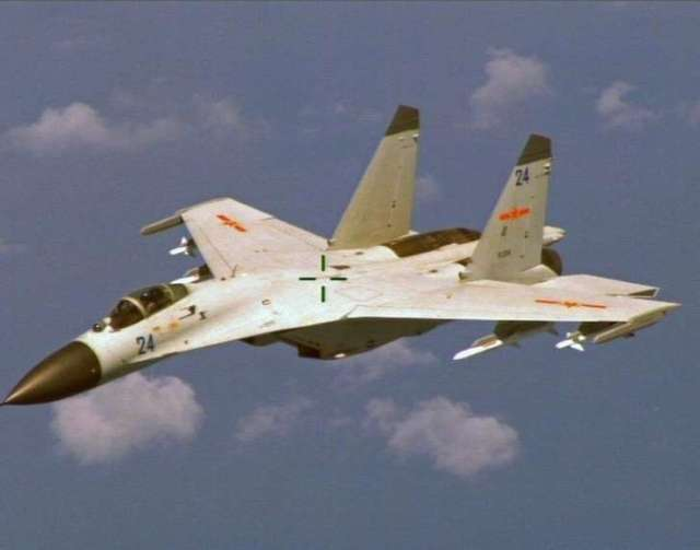 red alert chinese j 11 fighter jet flying near a us navy p 8 poseidon1