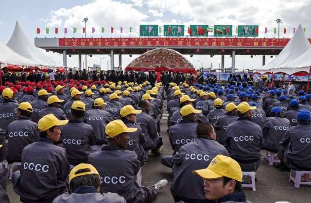 RED CHINA - RED ALERT - BRINKMANSHIP : RED CHINA IS INVESTING BILLIONS OF DOLLARS AND DISPATCHING MILLIONS OF CHINESE WORKERS TO FURTHER ITS EXPANSIONIST POLICY THAT MAKES CONFLICTS WITH OTHER NATIONS INEVITABLE. IN THIS PHOTO IMAGE, ETHIOPIAN AND CHINESE CONSTRUCTION WORKERS SEEN WAITING NEAR CHINA COMMUNICATION CONSTRUCTION COMPANY BUILDING ADDIS ABABA - ADAMA TOLL ROAD.