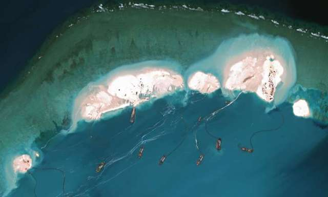 Red China -  Land Reclamation Activity in   South China Sea.