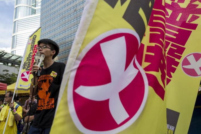 Student leader Joshua Wong chants slogans during a march to demand lawmakers reject a Beijing-vetted electoral reform package for the city's first direct chief executive election in Hong Kong, China June 14, 2015. Thousands of people took to the streets of Hong Kong on Sunday to protest against electoral reforms approved by Beijing to choose the city's next leader, the beginning of several days of demonstrations before the reforms go to a vote. REUTERS/Tyrone Siu