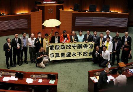 Pro-democracy lawmakers chant slogans after voting at Legislative Council in Hong Kong, China June 18, 2015.   REUTERS/Bobby Yip