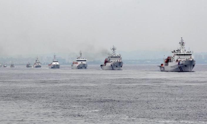 Taiwan Coast Guard patrol ships are seen during a drill held about 4 nautical miles out of the port of Kaohsiung, southern Taiwan, June 6, 2015. Taiwan's coast guard on Saturday commissioned its biggest ships for duty, in the form of two 3,000 ton patrol vessels, as Taipei boosts its defences amid concerns about China's growing footprint in the disputed South China Sea. REUTERS/Pichi Chuang