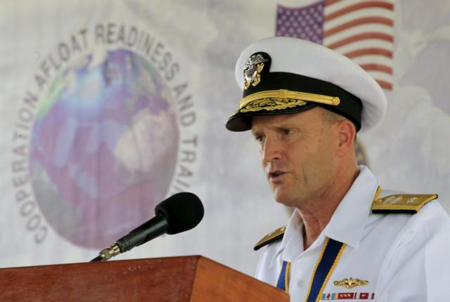 U.S. Navy Rear Admiral William Merz delivers a statements during the opening ceremony of Cooperation Afloat Readiness and Training (CARAT) 2015 at navy headquarters in Puerto Princesa city, Palawan, west Philippines June 22, 2015. The Philippines will hold separate naval exercises with U.S. and Japanese forces this week on a Philippine island that is not far from the disputed Spratly archipelago, where China's rapid creation of seven island outposts is stoking regional tensions.  REUTERS/Romeo Ranoco