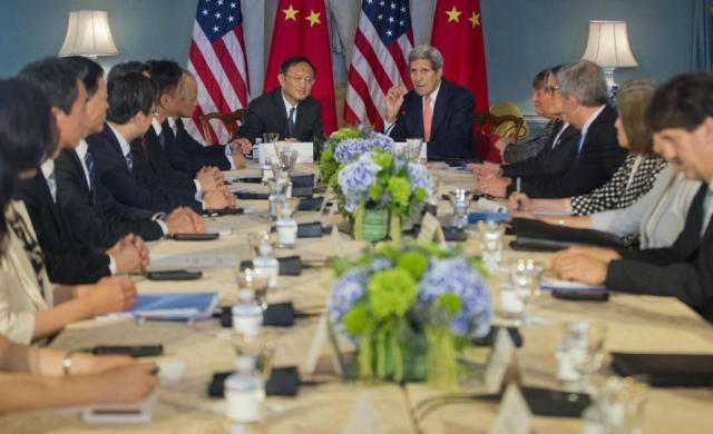 Secretary of State John Kerry, China's State Councilor Yang Jiechi, left, and others, participate in the Strategic Track Ocean meeting during the US China Strategic and Economic Dialogue (S&ED), Wednesday, June 24, 2015, at the State Department in Washington. (AP Photo/Pablo Martinez Monsivais)