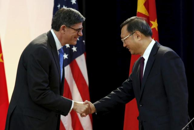 U.S. Treasury Secretary Jack Lew (L) shakes hands with Chinese State Councilor Yang Jiechi at the Strategic and Economic Dialogue (S&ED) at the State Department in Washington June 23, 2015. More than 400 Chinese officials are in Washington for annual talks under the wide ranging Strategic and Economic Dialogue (S&ED) framework, which will involve eight U.S. cabinet secretaries. REUTERS/Yuri Gripas