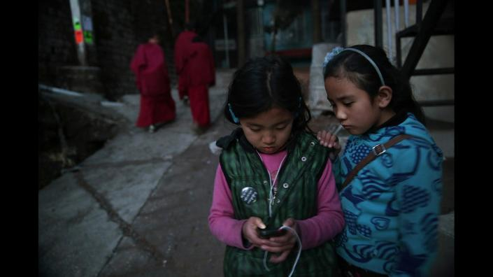 WHAT IS TIBET'S FUTURE? THESE TWO KIDS, TENZIN DHAYSEL(LEFT), AND TENZIN NORZOM ARE BORN IN INDIA TO TIBETAN PARENTS LIVING IN EXILE.