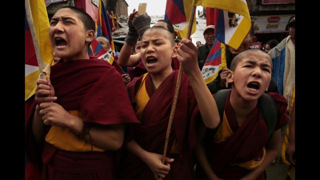 WHAT IS TIBET'S FUTURE?  TIBETAN UPRISING DAY, MARCH 10, 2014. YOUNG TIBETAN MONKS PROTESTING TIBET'S MILITARY OCCUPATION.
