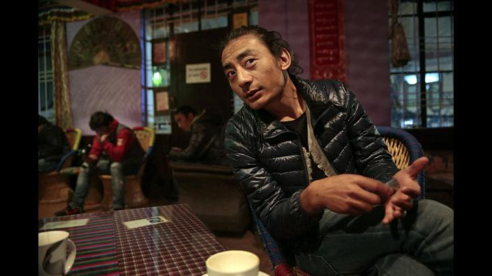 WHAT IS TIBET'S FUTURE?   TASHI IN BLACK TENT CAFE, McLEOD GANJ SAYS FINDING JOBS HAS BECOME DIFFICULT. HE MAY RETURN TO TIBET TO FIND EMPLOYMENT.