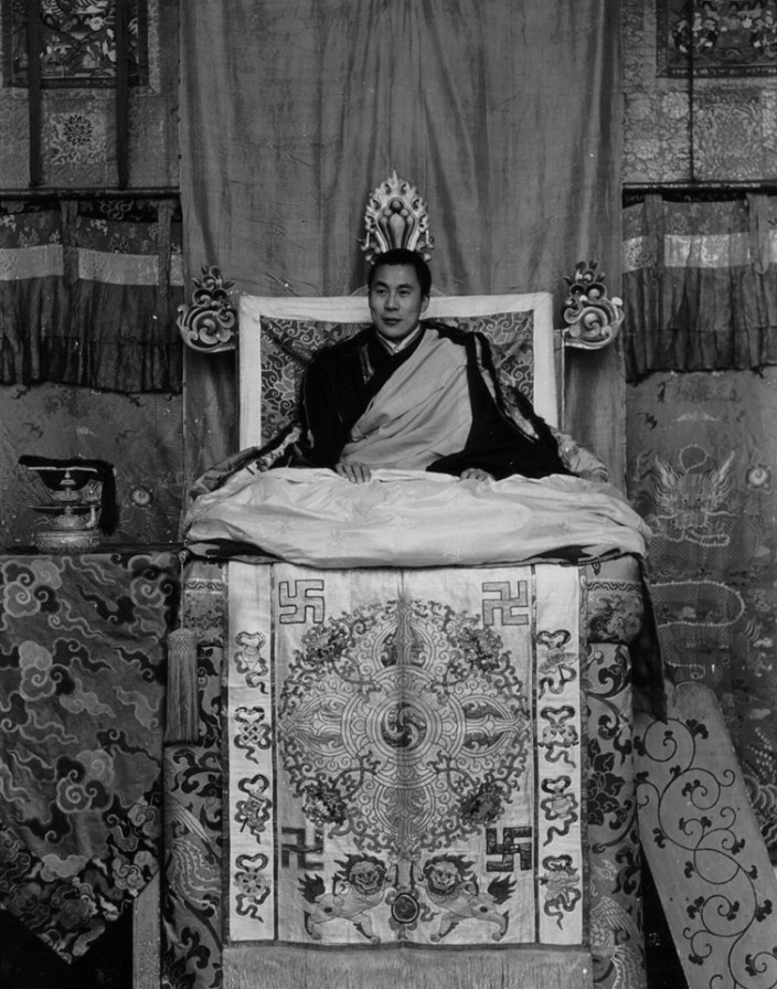 HIS HOLINESS THE 14th DALAI LAMA - PRINCE OF PEACE: The Dalai Lama is seen seated on his throne in Potala Palace, Lhasa, Tibet in this photo image from 1956/1957.