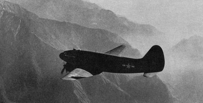 """Special Frontier Force Reviews Hump Airlift Operation - China-Burma-India Theater, World War II. C-46 Transport Plane flying east of Salween River. """"HUMP"""" refers to Mountains that separate Salween and Mekong Rivers."""