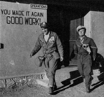 """Special Frontier Force Reviews Hump Airlift Operation, China-Burma-India Theater, World War II. Hump Fliers  Captain """"Bamboo"""" Joe Barube and Lieutenant Ernest Lajoie returning from China Operations Office."""