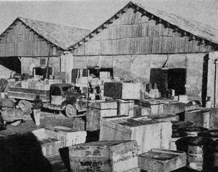 Special Frontier Force Reviews Hump Airlift Operation, China-Burma-India Theater, World War II. Air Depot in China showing freight received from India.