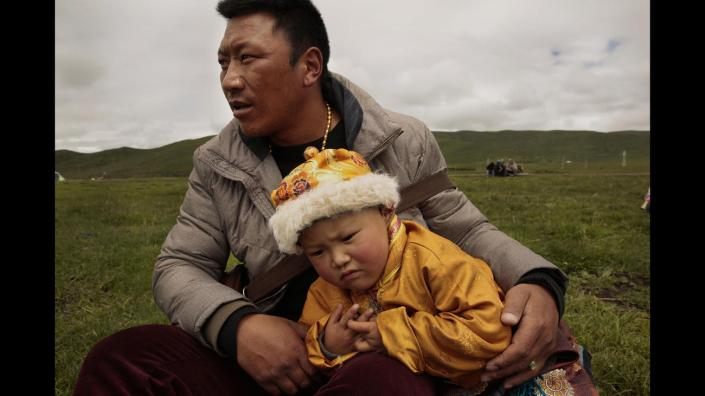 TIBET AWARENESS. TIBET'S ROAD TO MARTYRDOM. FATHER AND SON OF ANQU TOWN.