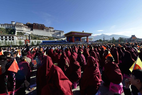 Thousands of people gather in front of the iconic Potala Palace in the regional capital Lhasa on September 8, 2015, for an event billed as marking 50 years since the founding of the administrative area of Tibet. China on September 8 stressed Communist party control over Tibet, with a senior official denouncing the Dalai Lama at a giant ceremony condemned by rights groups.        AFP PHOTO   CHINA OUT