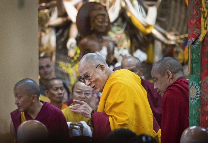 TIBET AWARENESS - PAIN AND COMPASSION:Tibetan spiritual leader the Dalai Lama, center, greets devotees as he arrives to give a talk at the Tsuglakhang temple in Dharmsala, India, Monday, Sept. 7, 2015. The four day religious talk organized for the Southeast Asian Buddhists will end Thursday.  (AP Photo/Ashwini Bhatia)