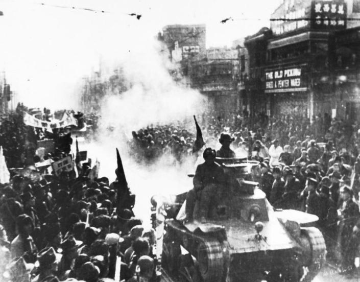 FILE - In this May 2, 1949 file photo, a column of Chinese Communist light tanks enter the streets of Peking, which are filled with people watching the conquerors pass. In 1949, Chiang Kai-shek's Nationalists lost the Chinese civil war to Mao Zedong's Communists and retreat from the Chinese mainland to the island of Taiwan. The Republic of China, however, retained China's Security Council seat with the key backing of the U.S. in order to restrain Mao's ally, the Soviet Union, as the Cold War unfolds. (AP Photo, File)
