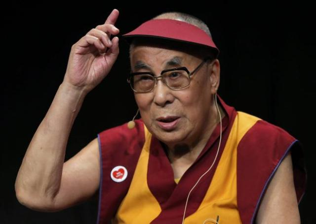 Tibet's exiled spiritual leader the Dalai Lama gestures as he attends a meeting with youth in Strasbourg, France, September 15, 2016. REUTERS/Vincent Kessler