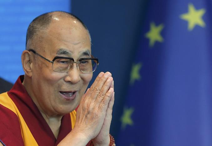 Tibet's exiled spiritual leader the Dalai Lama gestures as he arrives to deliver a speech at the Council of Europe in Strasbourg, France, September 15, 2016. REUTERS/Vincent Kessler