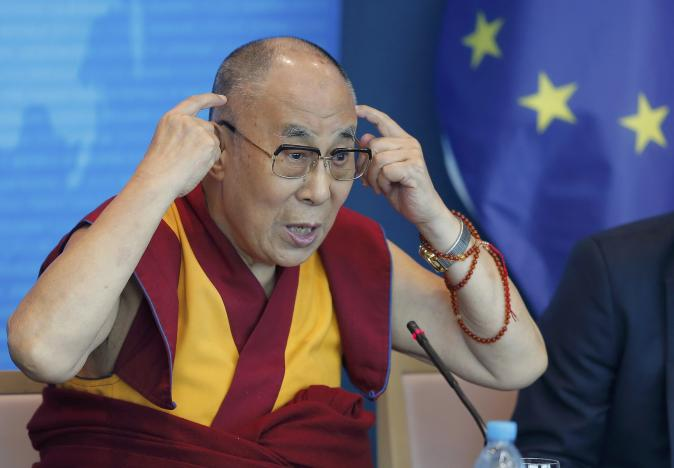 Tibet's exiled spiritual leader the Dalai Lama gestures as he delivers a speech at the Council of Europe in Strasbourg, France, September 15, 2016. REUTERS/Vincent Kessler